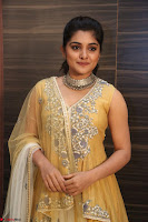 Nivetha Thamos in bright yellow dress at Ninnu Kori pre release function ~  Exclusive (70).JPG