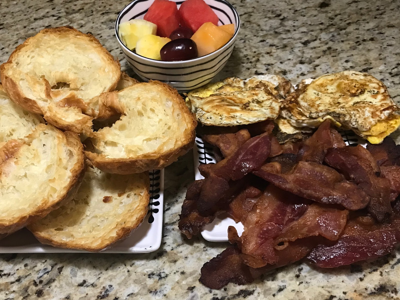 Image: Croissants, bacon, eggs on a plate