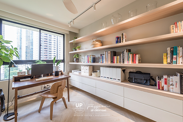 Mont Kiara Pines condo study room with wood texture shelf and white color cabinet and a solid wood study table