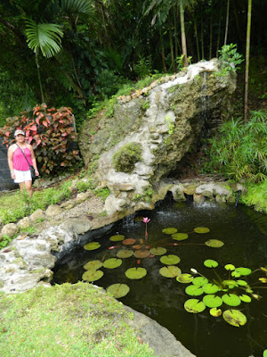 Linda at the waterfall Orchid World Barbados by garden muses-not another Toronto gardening blog