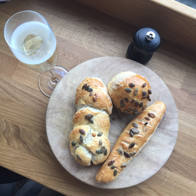 Homemade bread rolls and prosecco