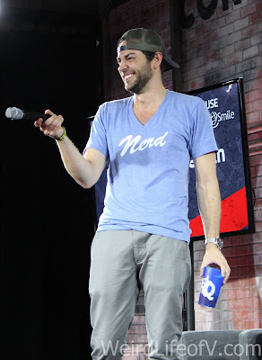 Zachary Levi laughing at something an audience member said or did