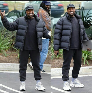 Kanye West smiles at the Paparazzi as they congratulate him on birth of his third child