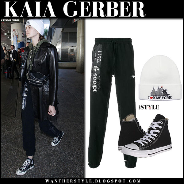 Kaia Gerber in black leather jacket and black sweatpants adidas model street fashion january 25