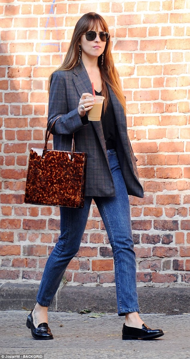 Dakota Johnson looks effortlessly chic as she goes for a quick coffee grab in NYC