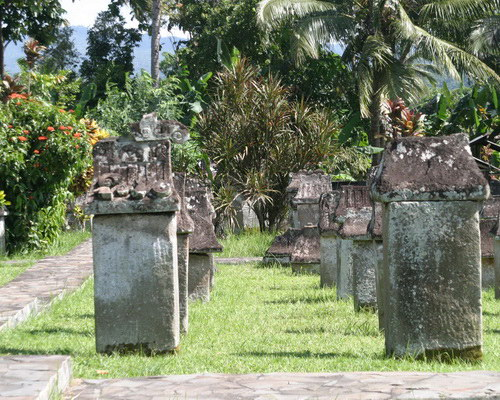 Tinuku.com Travel Waruga park megalithic tombs sites containing stone coffins to bury the Minahasa in North Sulawesi