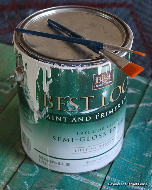 use glossy latex paint to hand letter a sign