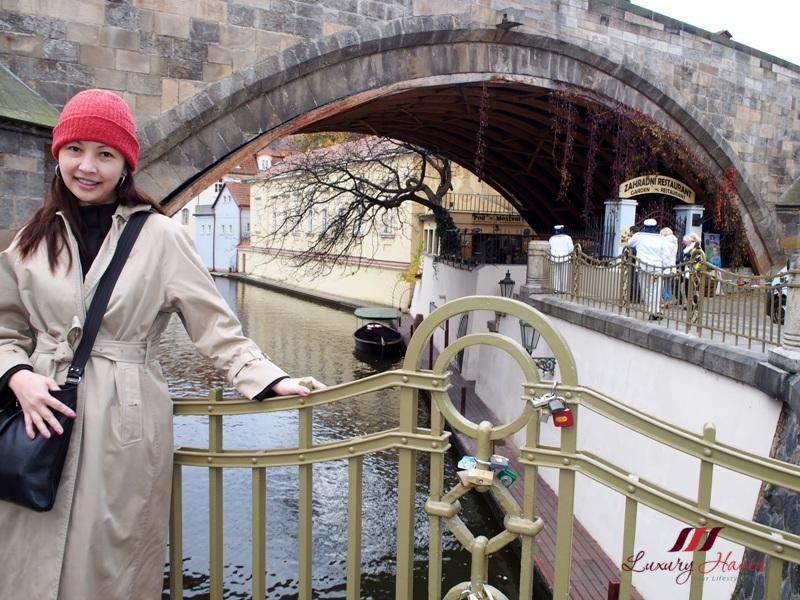 travel blogger explores prague charles bridge vltava river