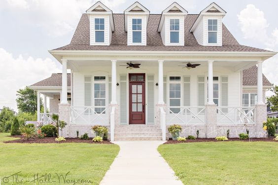 Dormers and charm beautiful white home exterior seen on Hello Lovely Studio