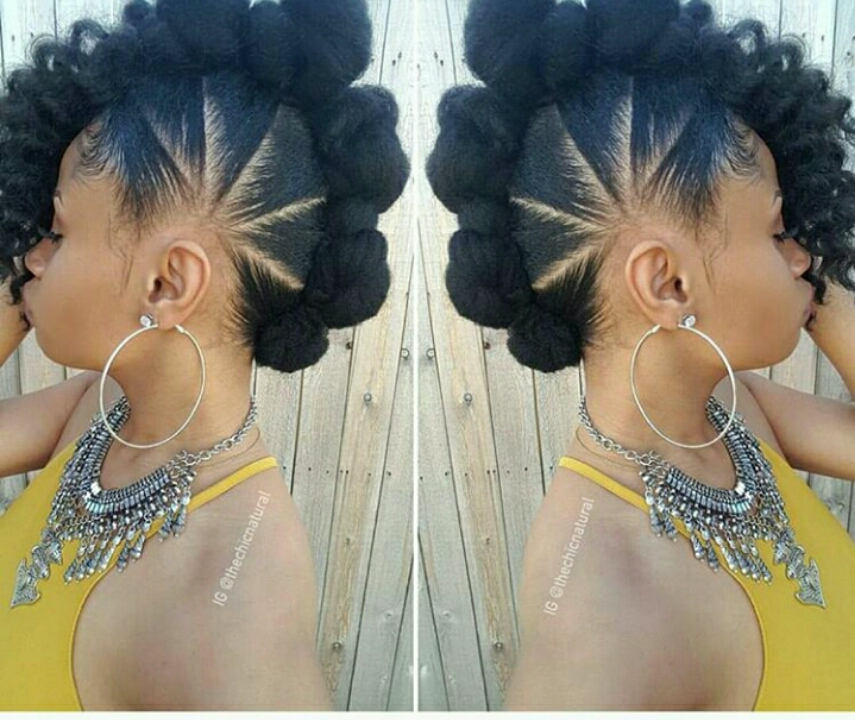 Updo Style on natural hair with a neat twist on a beautiful woman