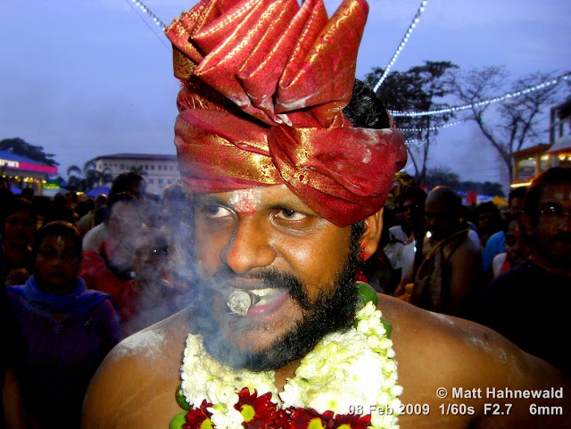 Thaipusam Festival; Malaysia; Kuala Lumpur; Batu Caves; ceremonial sacrifice; ceremonial offering; Tamil man; Hindu man; Malaysian Indian man; portrait; headshot