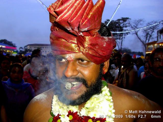 Thaipusam Festival; Malaysia; Kuala Lumpur; Batu Caves; ceremonial sacrifice; ceremonial offering; Tamil man; Hindu man; Malaysian Indian man; portrait; headshot