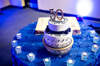 A Simple Cake Stating Happy 50th Birthday Demo And Demo50 More Upscale Lined With Blue Details Decorations Golden 50 Sitting On