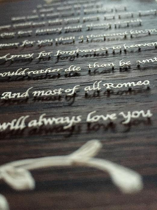 Romeo and Juliet (the Ultimate Love) paper cut lettering