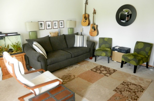 living room with hanging guitars