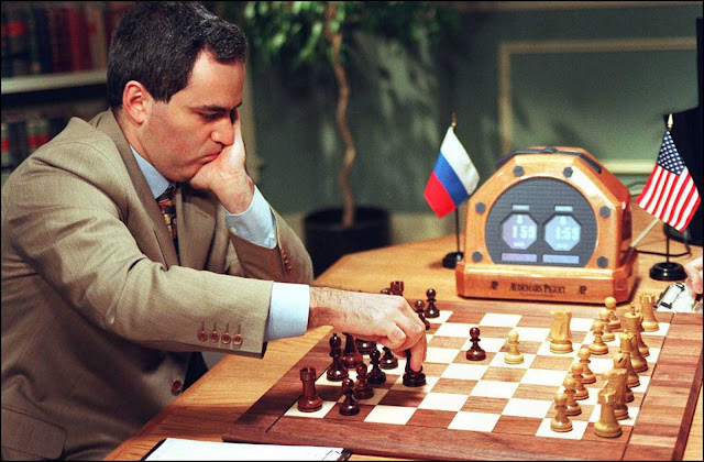 Kasparov makes a move in Game 2.