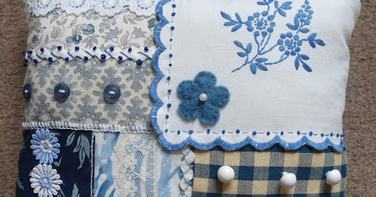 The blue and white patchwork pillow