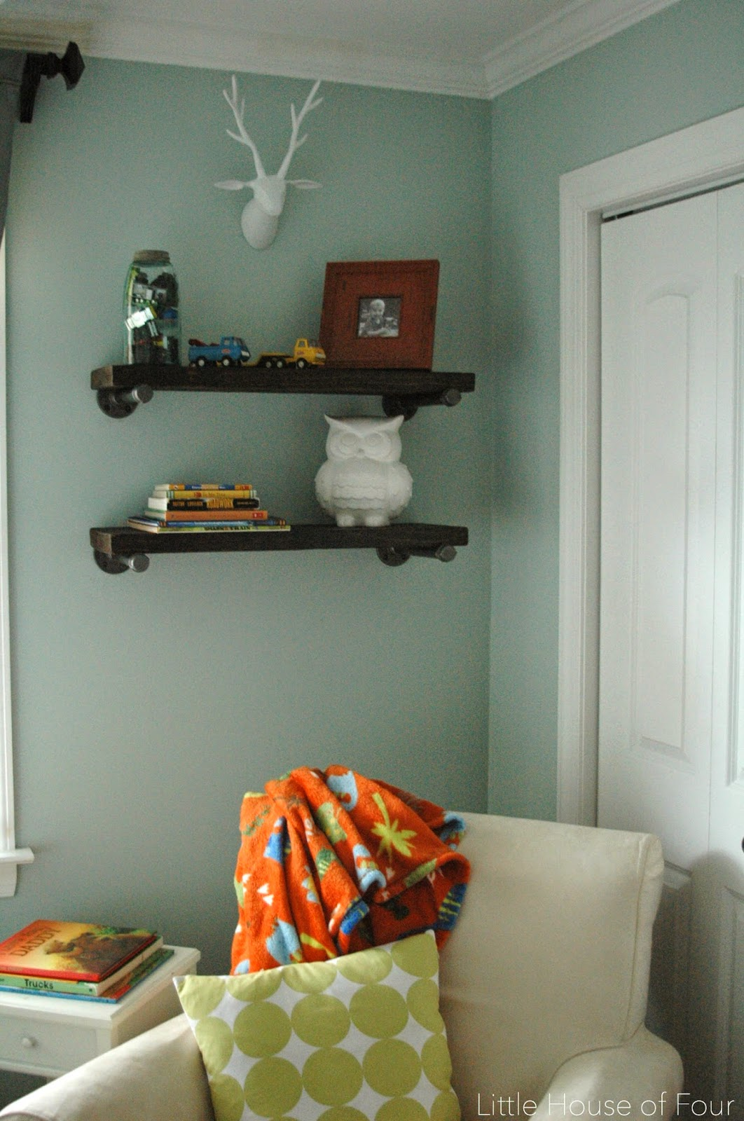 DIY wood and steel pipe shelves