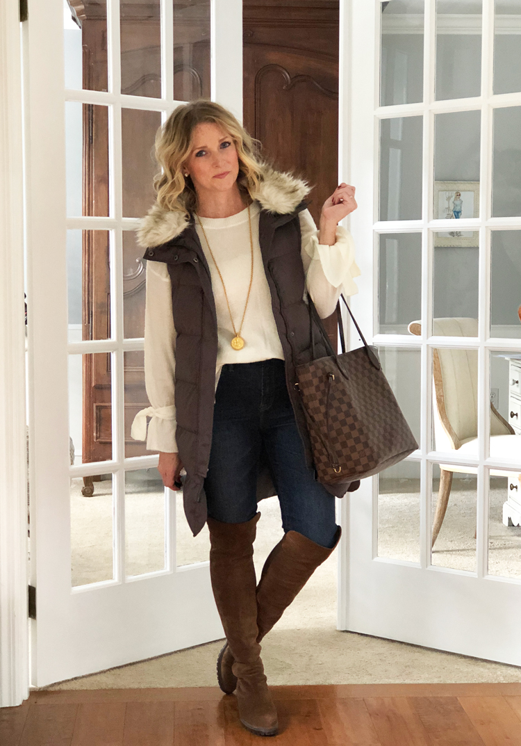 tie sleeve sweater with puffer vest and over the knee boots