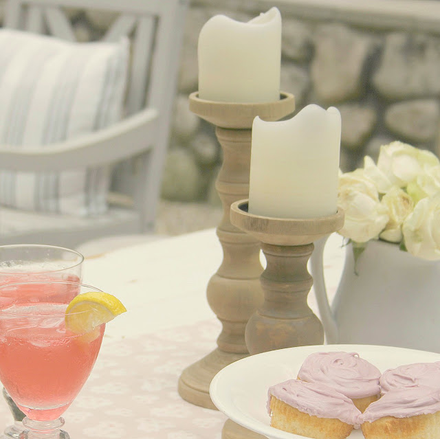Frosted cupcakes on white ironstone pedestal and pink lemonade - Hello Lovely Studio