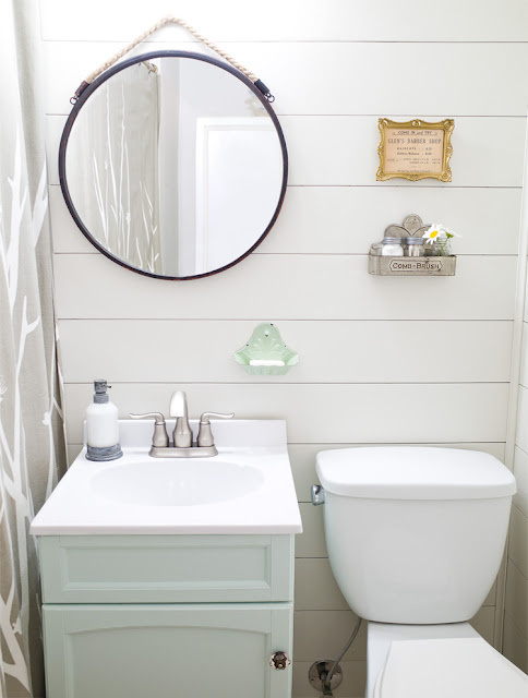 shiplap bathroom wall round mirror