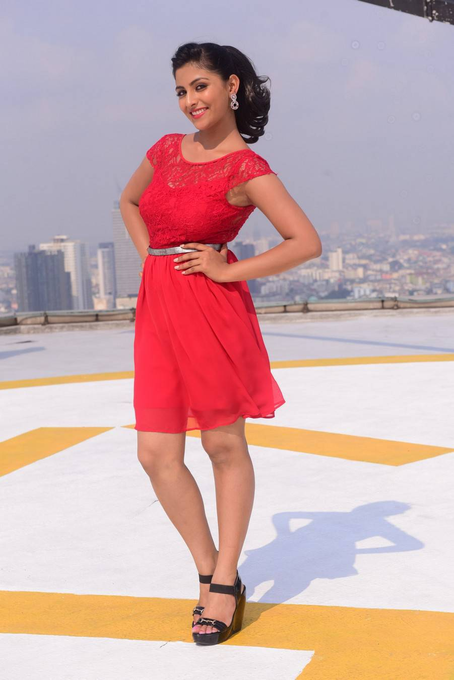 Tollywood Actress Kruthika Legs Thighs Show Stills In Red Mini Skirt