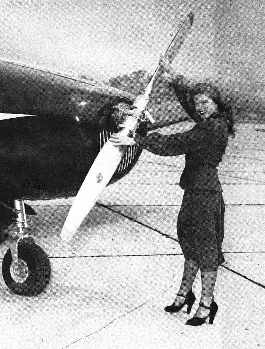 photograph of a woman at a plane's propeller, from a 1949 aviation magazine