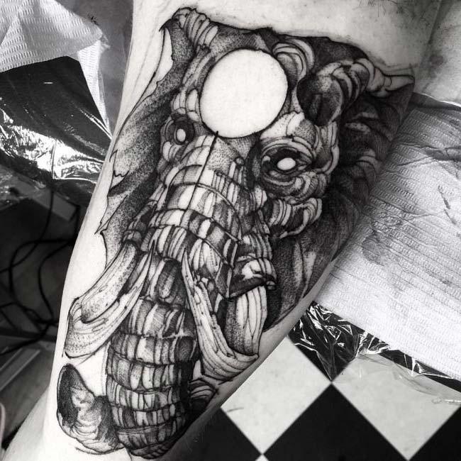 strong elephant tattoo