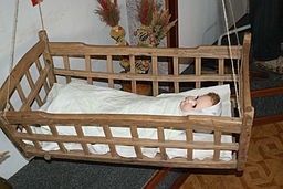 baby doll in crib on onequartermama.ca safe bed, safe baby