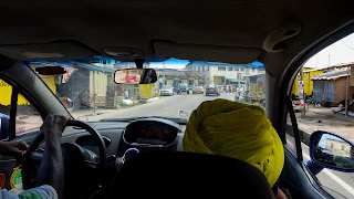 Riding a shared taxi in Accra. This is how it looks like.