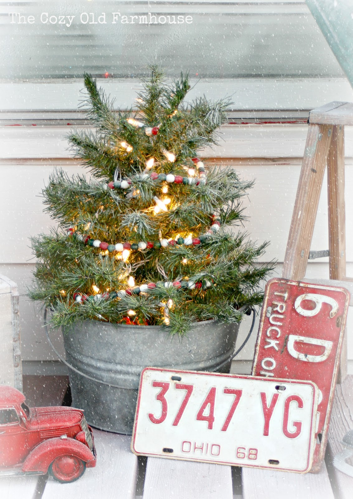 The cozy old farmhouse a junky christmas porch for Christmas tin pails