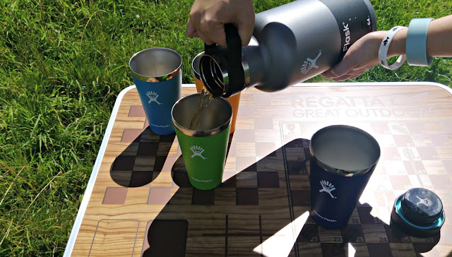 Hydro Flask Beer Growler pouring beer into Hydro Flask Tumblers