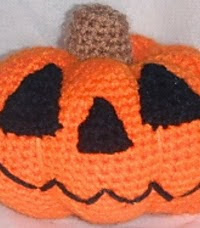 http://www.ravelry.com/patterns/library/free-pattern--pumpkin-smiles
