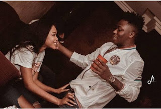 Reekado Banks and mystery girl