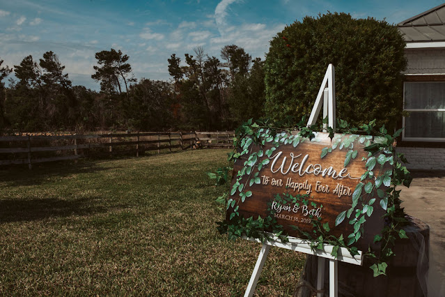 Wooden welcome sign at Bella Ranch