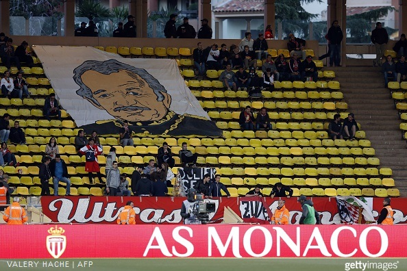 A giant flag of Prince's Rainier III is display on the anniversary of his death on April 6 2005, during the French L1 football match Monaco (ASM) vs Montpellier (MHSC) on April 7, 2015 at the 'Louis II Stadium' in Monaco.