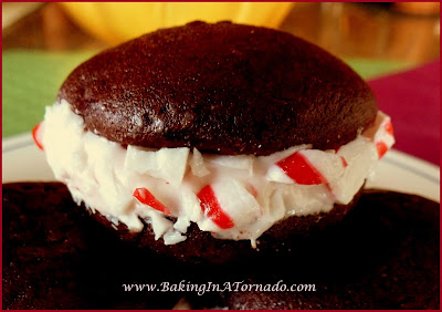 Peppermint Creme Sandwich Cookies: a chocolate devil's food cookies sandwiched with a peppermint creme center | Recipe developed by www.BakingInATornado.com | Blog With Friends: Traditions | #recipe #cookies #holiday #Christmas