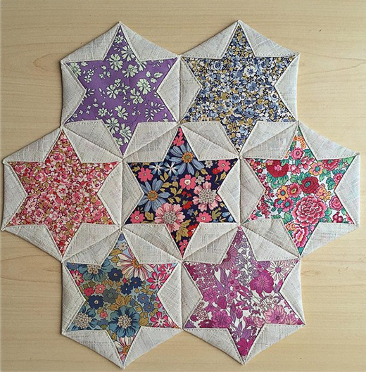 Folded Hexagon Stars Quilt Designed by Paula Tidman