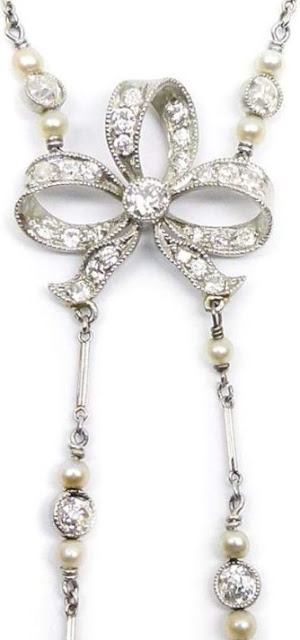 An antique diamond bow and pearl sautoir from the Belle Epoque era.