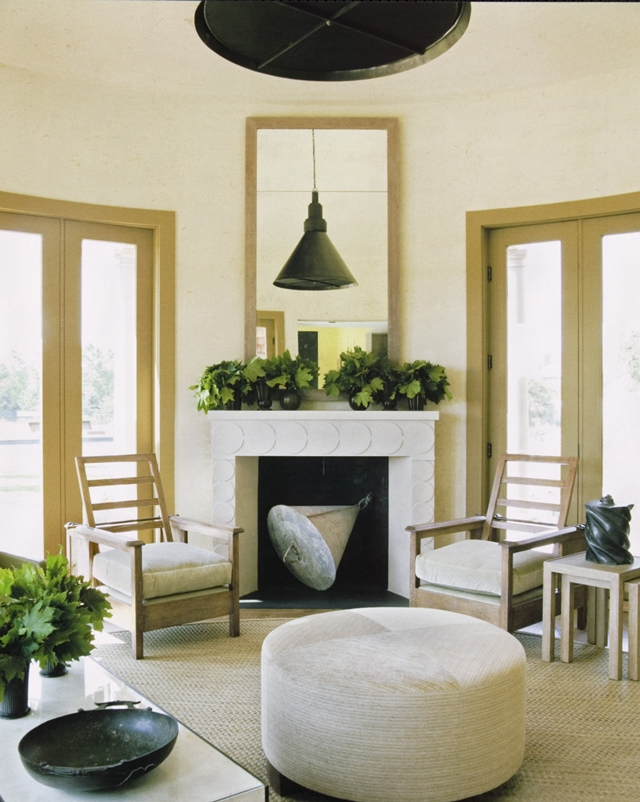 Photo of white fireplace in the living room with two shairs