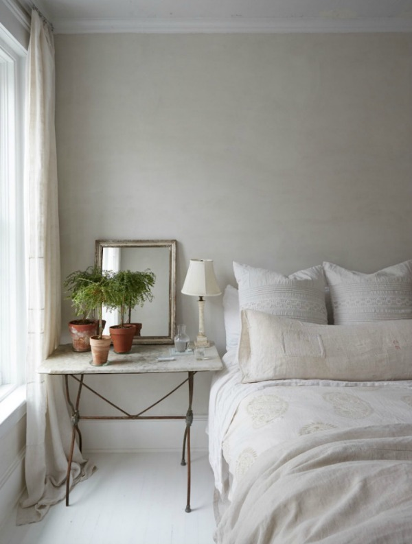 This serene bedroom with European rustic elegance looks as though it might be in the South of France, not New York...see more lovely examples of European farmhouse decor you can bring to your own spaces at home. #Europeanfarmhouse #elegantdecor #countrystyle