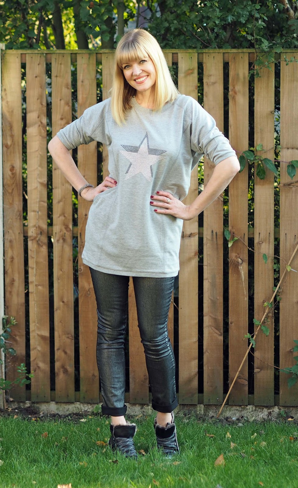 Longline star motif sweatshirt, silver slim leg metallic jeans, high-top black leather trainers, over 40