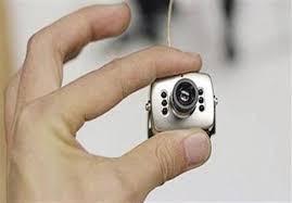 ضبط كاميرات تجسس مع راكب بمطار القاهرة ،داخل 20 لمبة