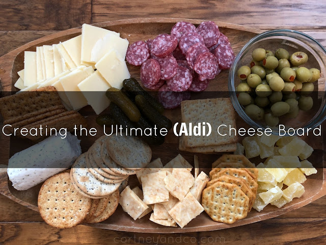 This beautiful and tasty cheese board won't break the bank. Everything's from Aldi and under $25~Cortneyandco.com