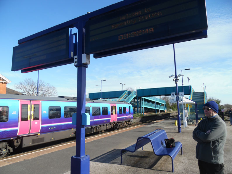 A TransPennine Express Passenger Train At Barnetby Station, Bound For  Cleethorpes. One Of The Waiting Shelters Provided For Passengers Can Be  Seen In The ...