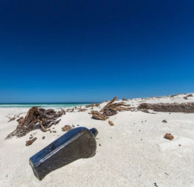World's oldest message in a bottle (from 1886) found half-buried in beach (photos)