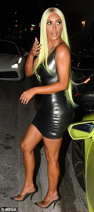Kim Kardashian channels sister Kylie Jenner as she debuts neon GREEN wig
