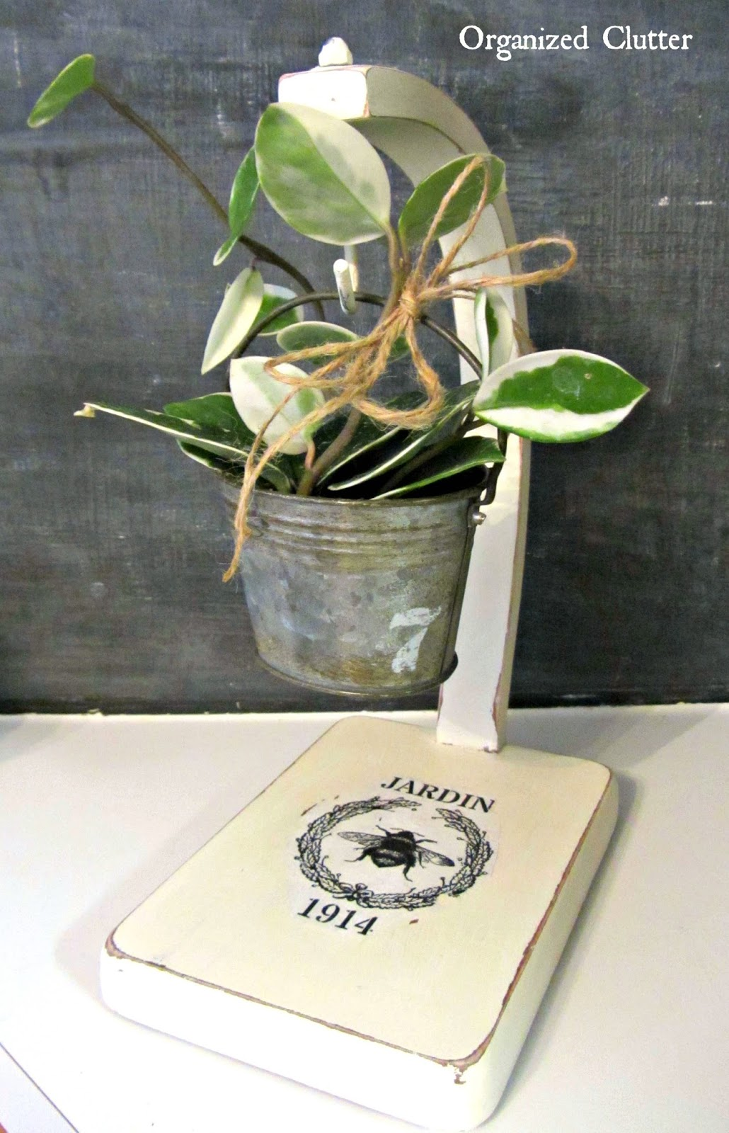 Wax Plant Displayed on Upcycled Banana Stand www.organizedclutterqueen.blogspot.com