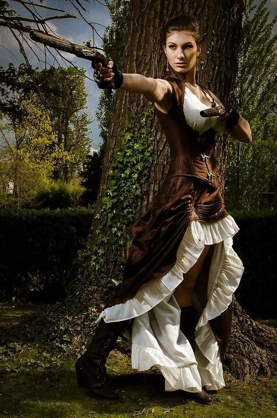Steampunk woman wearing a brown and cream silk corset and skirt with a raised hem. women's steampunk fashion and clothing