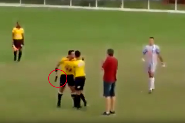Referee Camilo Eustáquio de Souza pulls out gun after allegedly being punched